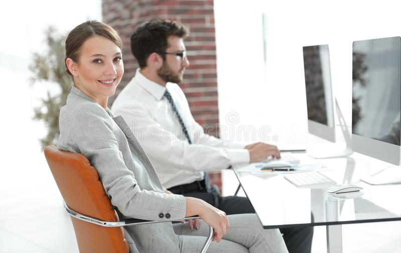 Portrait of confident business woman in her office stock photo