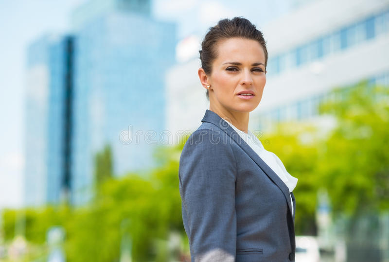 Portrait of confident business woman in modern office district royalty free stock photo