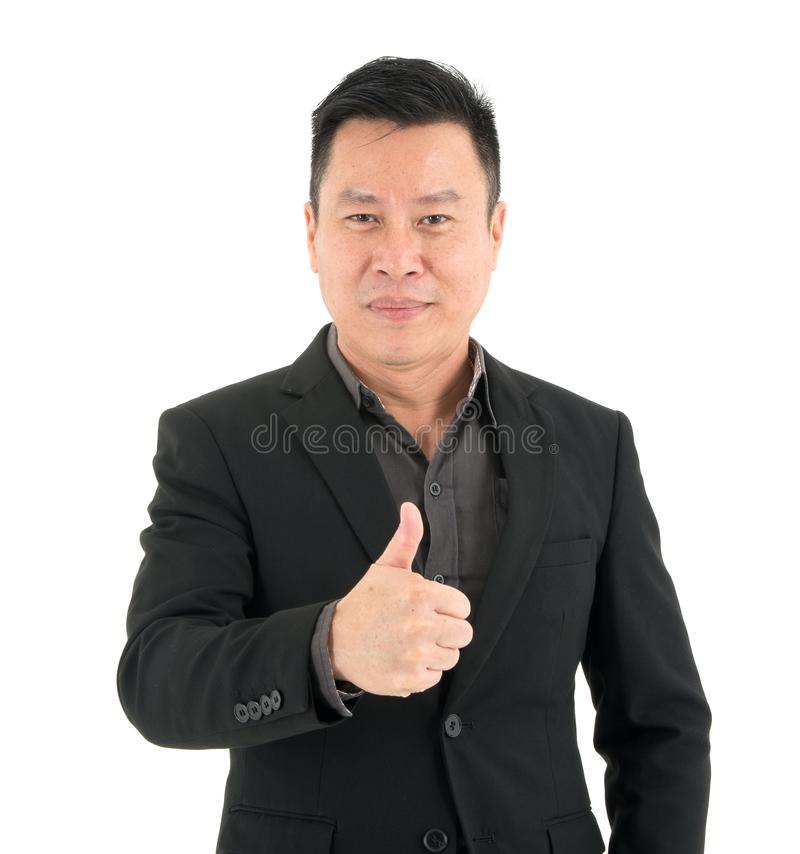 Portrait of confident businessman present confidence by showing thumb, isolated on white background stock photo