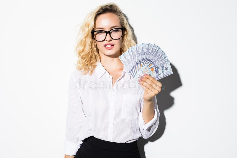 Portrait of a confident businesswoman showing bunch of money banknotes isolated over white background stock photo