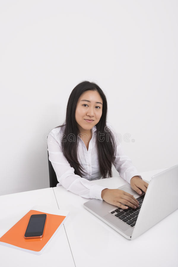 Download Portrait Of Confident Businesswoman Working On Laptop In Office Stock Photo - Image: 35900716