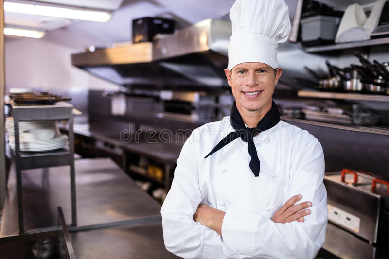 Portrait of confident chef standing in kitchen stock photos