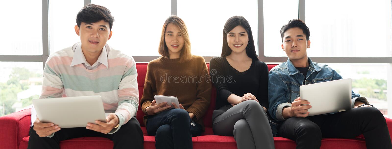 Young Business people are looking camera. stock photo