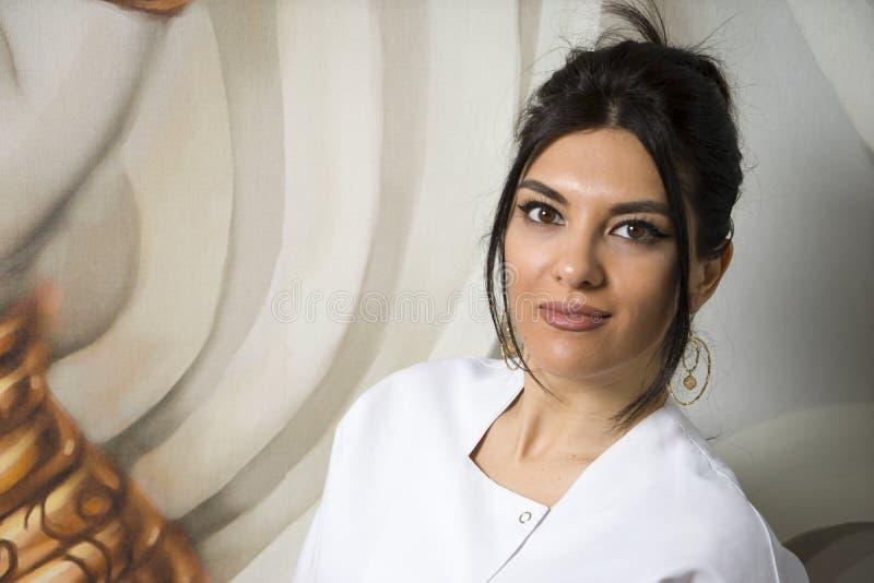 Portrait of confident female doctor standing in lab coat, stock photos