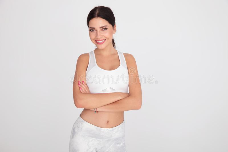 Portrait of confident fitness girl standing with arms folded royalty free stock image