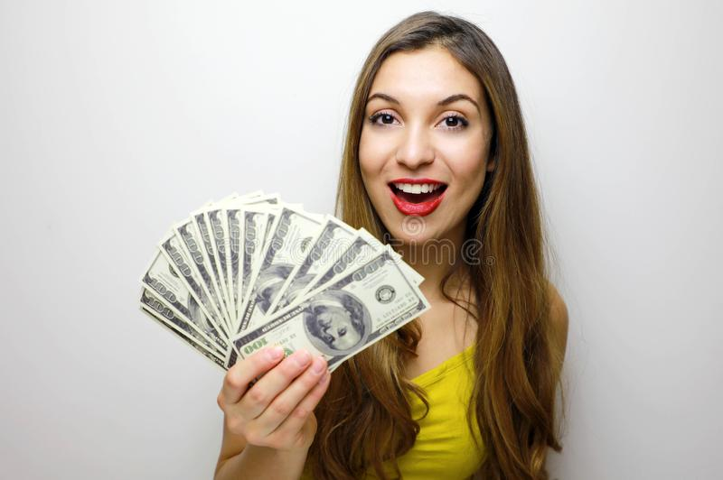 Portrait of a confident girl showing bunch of money banknotes isolated over white background royalty free stock photos