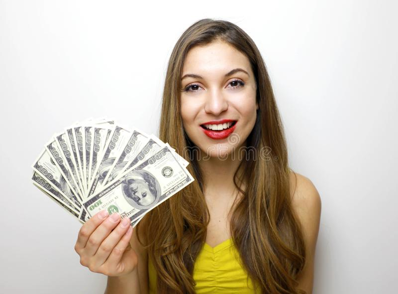 Portrait of a confident girl showing bunch of money banknotes isolated over white background royalty free stock photo