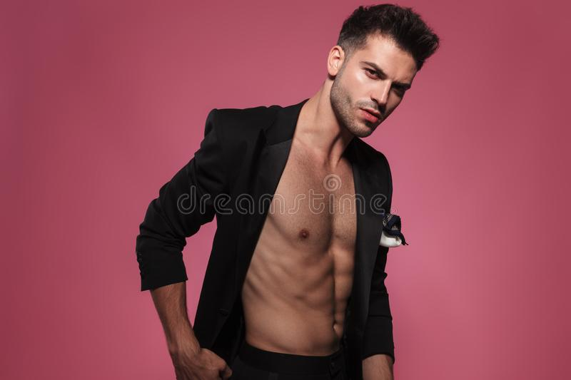 Portrait of confident handsome man wearin undone black tuxedo stock photography