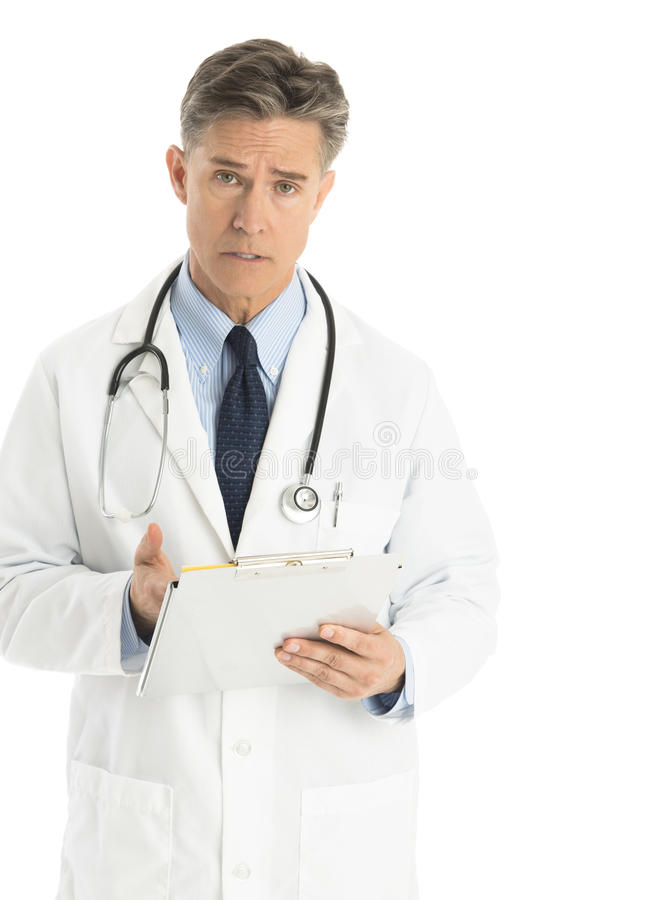 Download Portrait Of Confident Male Doctor Gesturing At Clipboard Stock Image - Image: 32062127