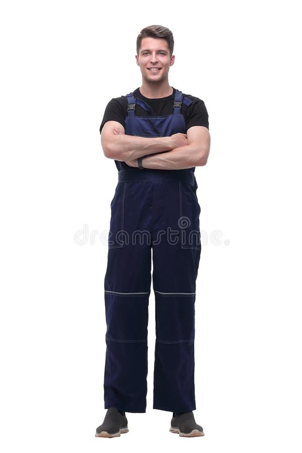 Portrait of confident man in overalls .isolated on white stock photos