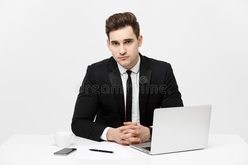 Portrait of confident manager sitting at desk and looking at camera. Portrait of business man working at computer royalty free stock photo