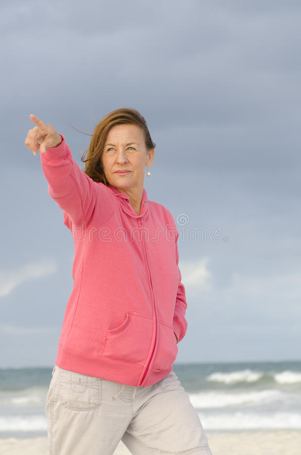 Portrait of confident mature woman at beach royalty free stock images