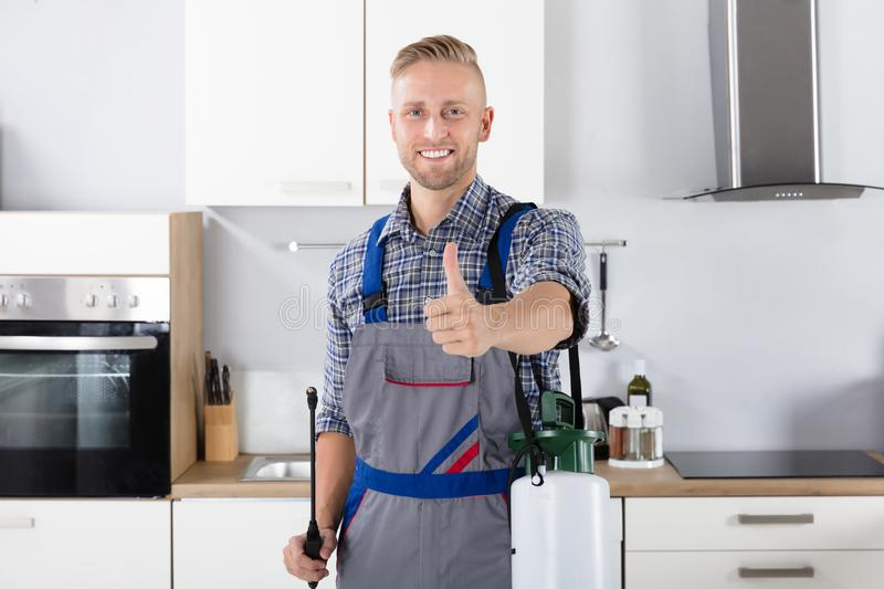 Confident Pest Control Worker With Pesticide Container royalty free stock photo