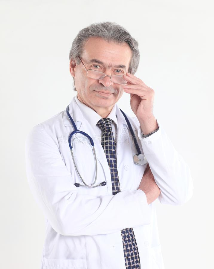 Portrait of a confident physician with stethoscope .isolated on white background royalty free stock image