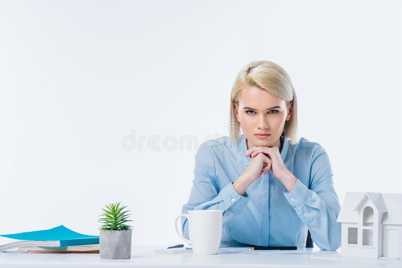 Portrait of confident real estate agent looking at camera. At workplace stock photo