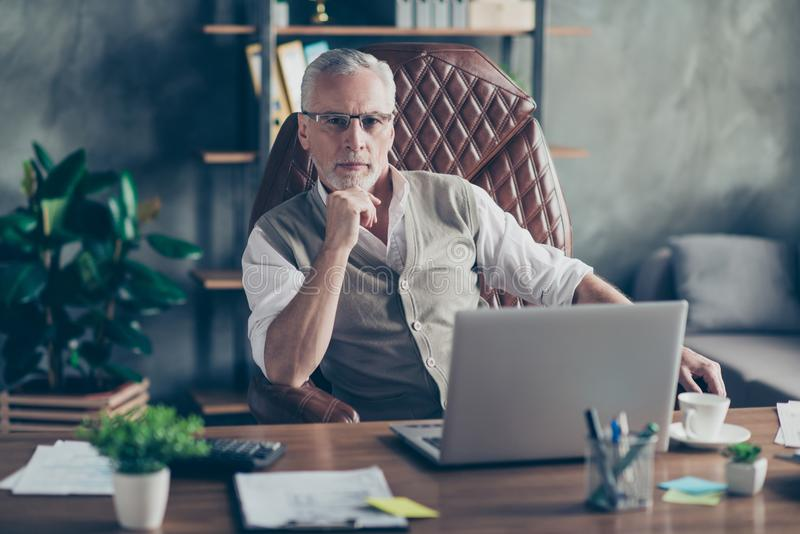 Portrait of confident serious strict concentrated pensive qualified smart clever self-assured head of a company dressed in waist stock photos