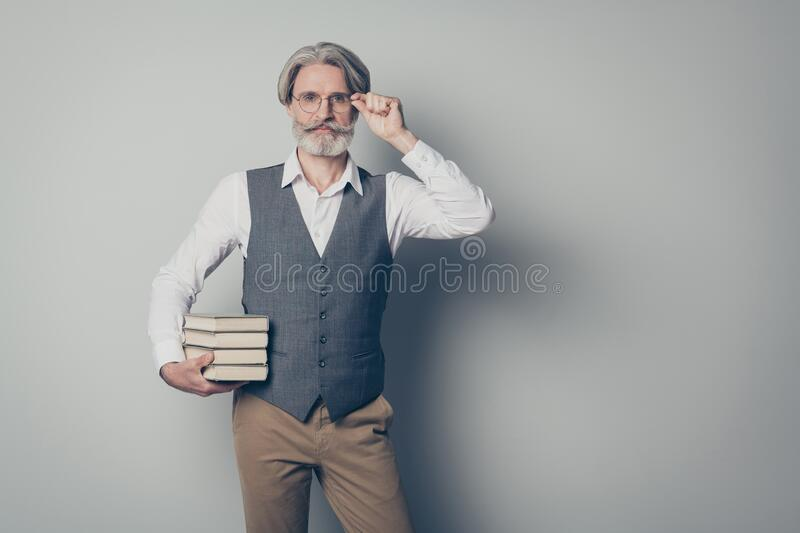 Portrait of confident smart old high school teacher man ready share knowledge on courses touch hands spectacles wear royalty free stock photo