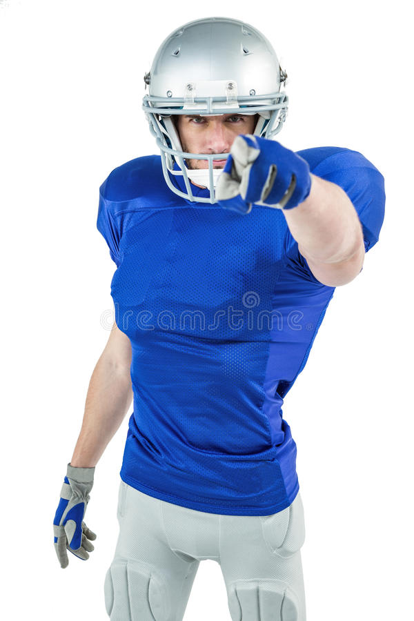 Portrait of confident sports player pointing. Against white background royalty free stock photos