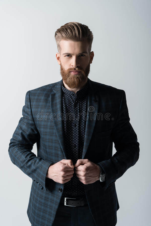Portrait of confident stylish bearded man in suit stock image
