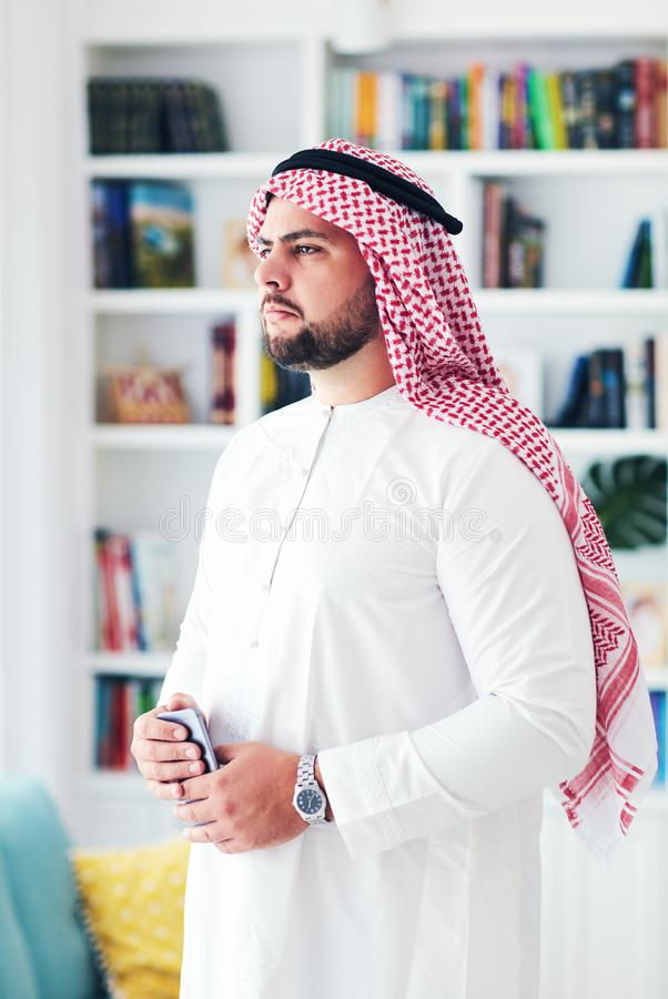 Portrait of confident young adult arabic man at home stock image