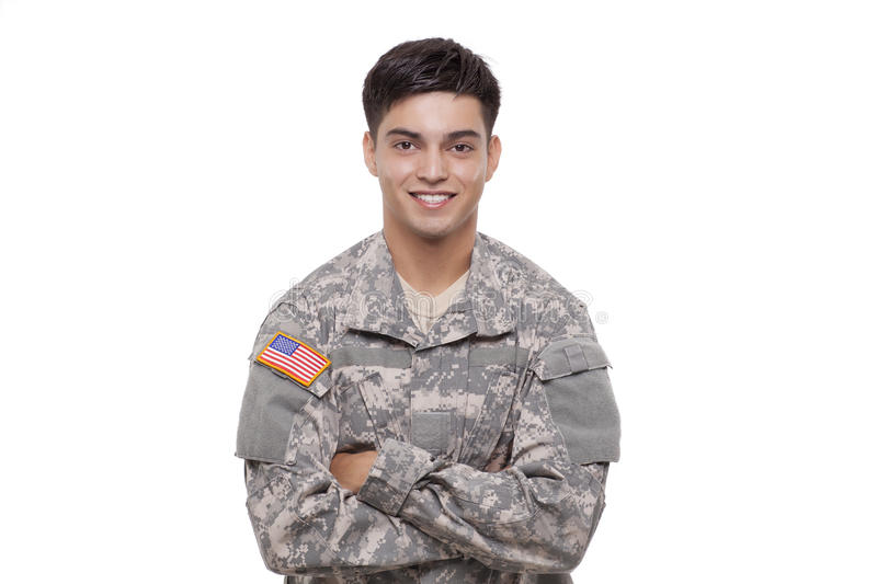 Portrait of a confident young American soldier with arms crossed. Confident young soldier with arms crossed royalty free stock image
