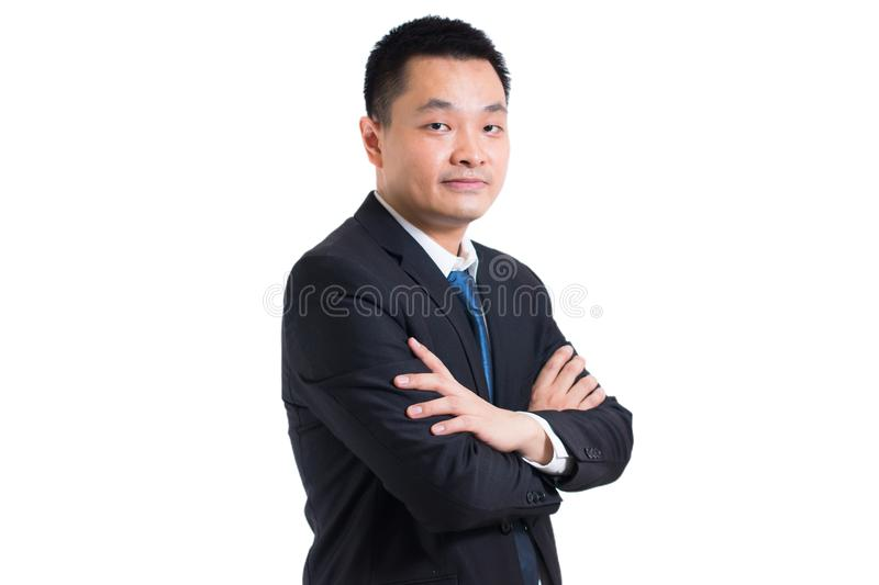 Portrait of Confident young asian businessman standing with arms folded. Businessman black suit arms crossed royalty free stock images