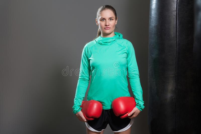 Portrait of a confident young athlete woman with collected hair royalty free stock images