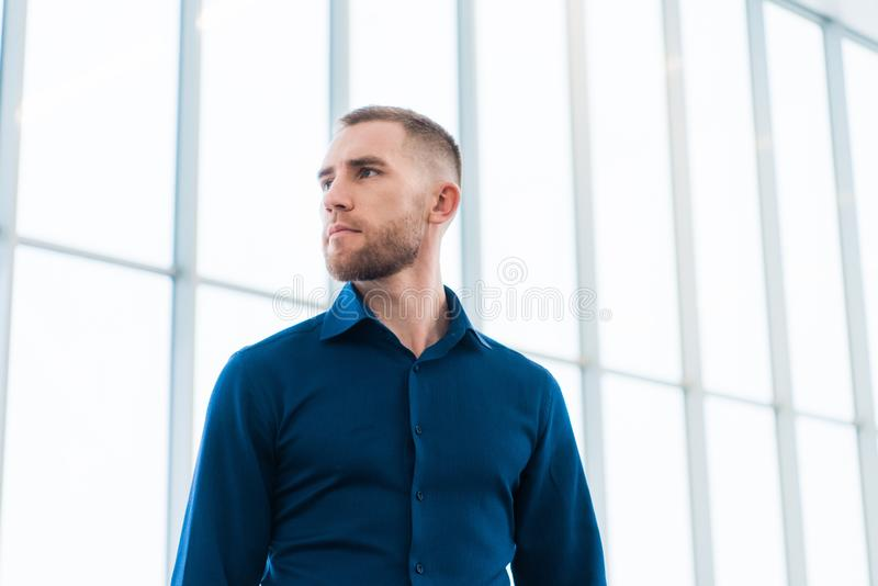 Portrait of a confident young business man looking away stock images