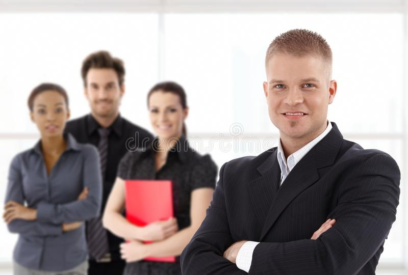 Portrait of confident young businessman and team royalty free stock photo
