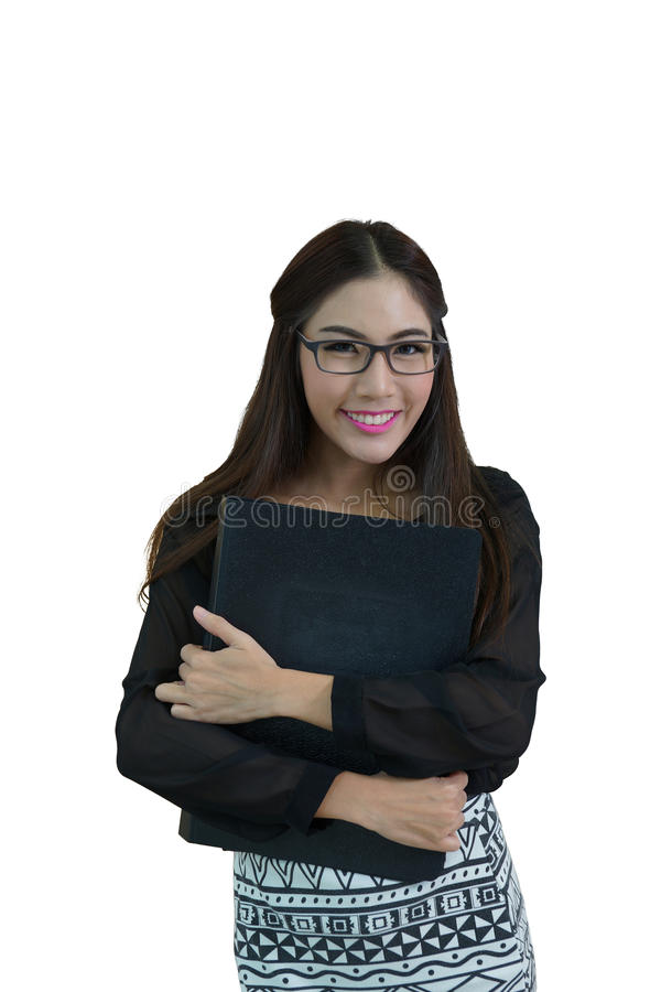 Portrait of confident young businesswoman with file folder in of stock images