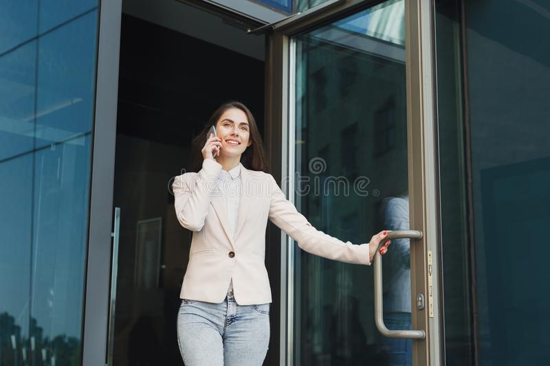 Portrait of a confident young businesswoman talking on cell stock photography