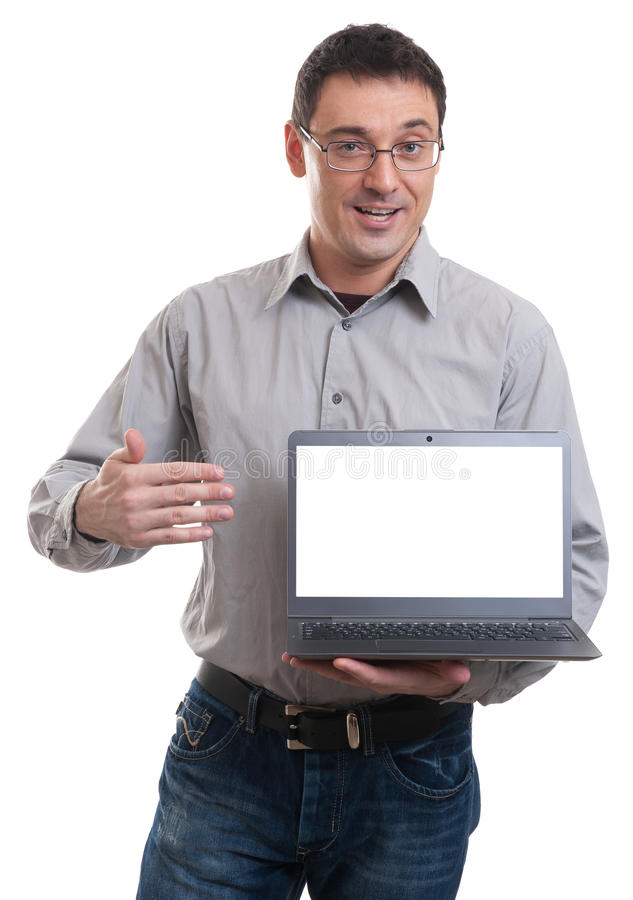 Portrait of confident young man advertising laptop royalty free stock photography