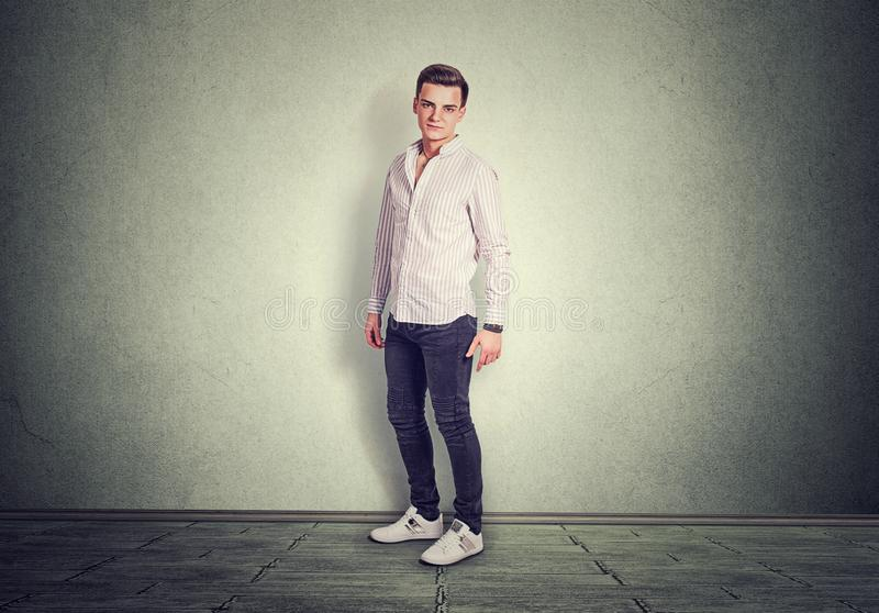 Full length man standing isolated on gray background grey floor in studio stock photo