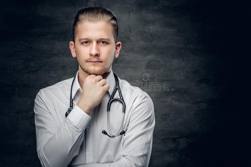 Studio portrait of young medical doctor. stock image
