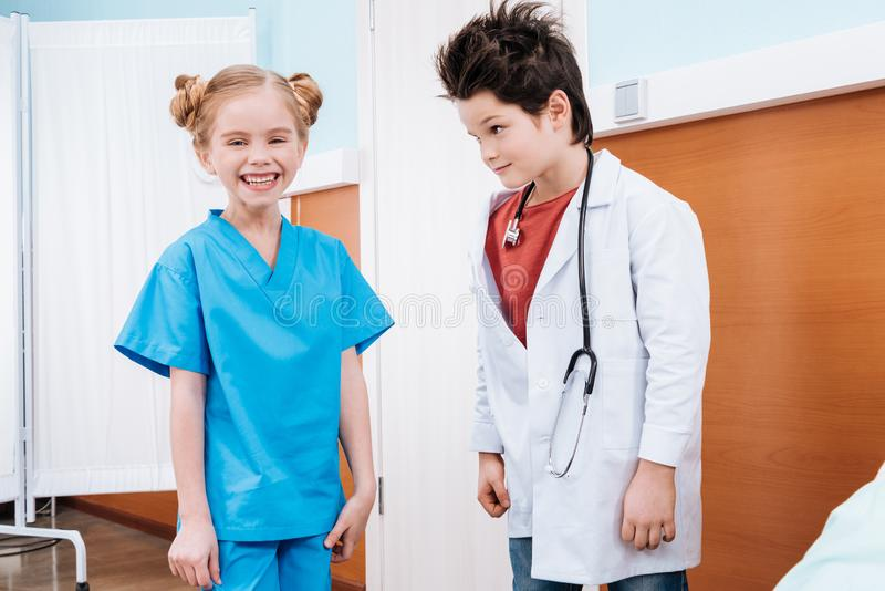 portrait of confused boy doctor with stethoscope royalty free stock photos