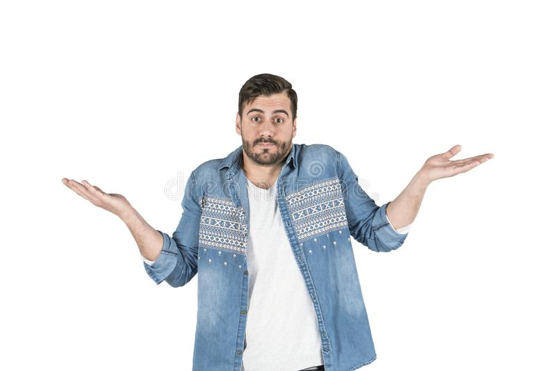 Portrait of confused handsome man giving I dont know gesture on white background royalty free stock photography