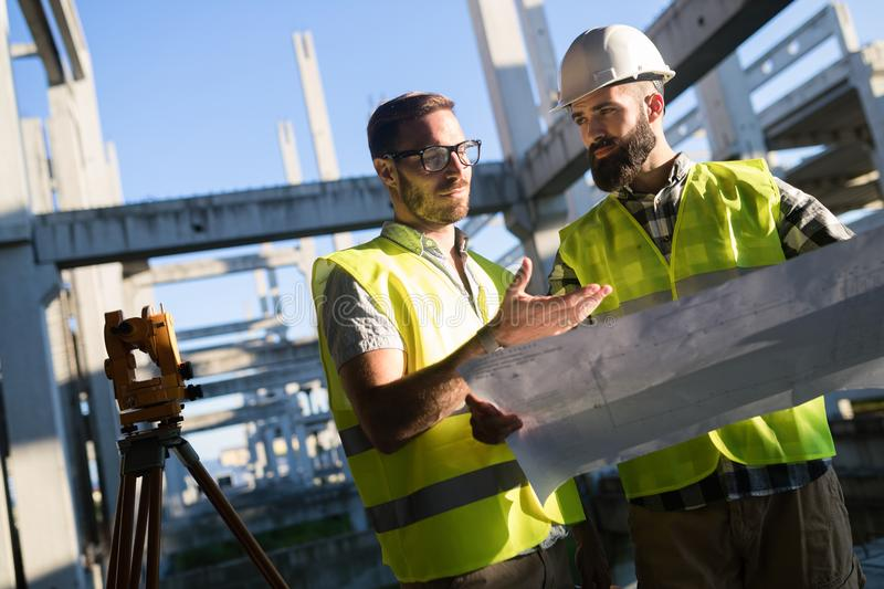 Portrait of construction engineers working on building site stock photography