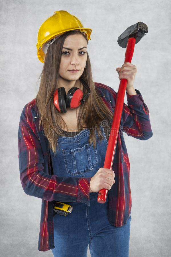 Portrait of construction worker with big hammer royalty free stock photos
