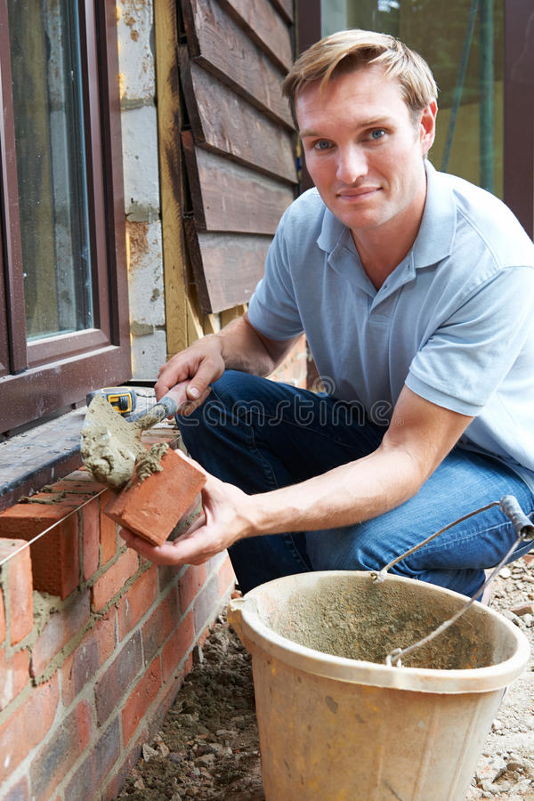 Portrait Of Construction Worker Laying Bricks royalty free stock photography