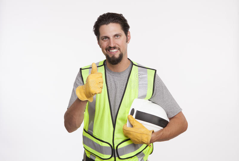 Portrait of a construction worker showing thumbs up stock images