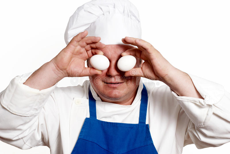 Portrait of the cook with eggs. Comically a portrait of the cook with eggs royalty free stock photography