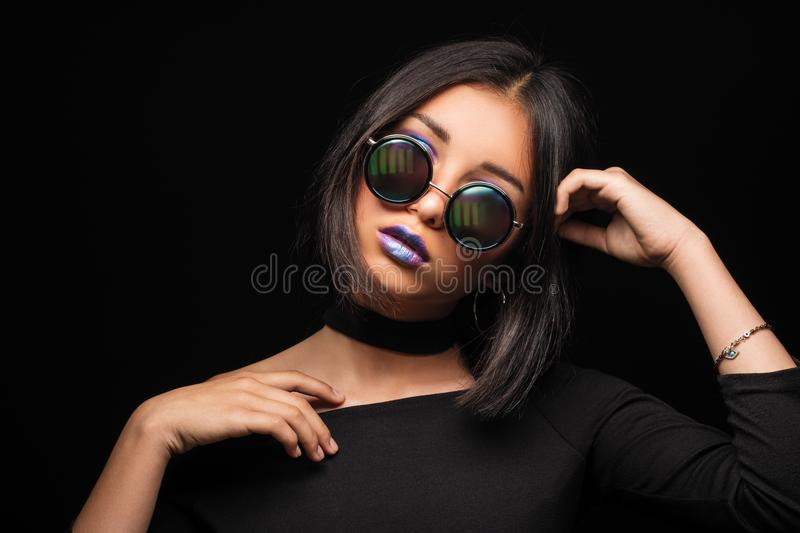 Portrait of cool crazy brunette fashionable girl in sunglasses,. Casual hairdo on black background. Woman like bitch with pretty makeup big lips stock photography