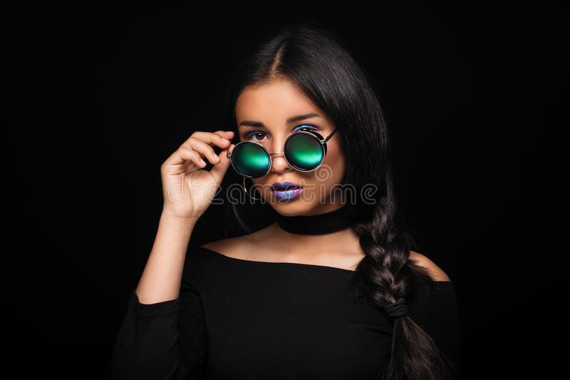 Portrait of cool crazy brunette fashionable girl in sunglasses,. Casual hairdo on black background. Woman like bitch with pretty makeup big lips stock photos