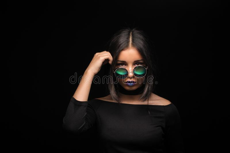 Portrait of cool crazy brunette fashionable girl in sunglasses,. Casual hairdo on black background. Woman like bitch with pretty makeup big lips stock image