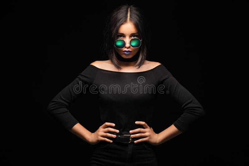 Portrait of cool crazy brunette fashionable girl in sunglasses,. Casual hairdo on black background. Woman like bitch with pretty makeup big lips royalty free stock images