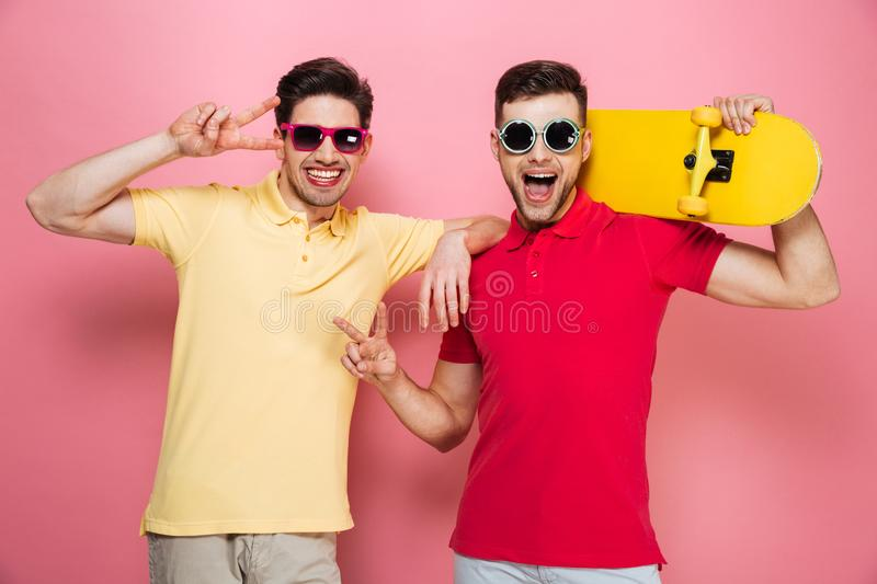Portrait of a cool gay male couple showing peace gesture royalty free stock photo