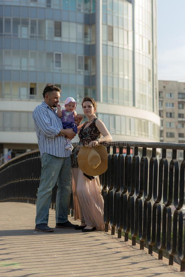 Couple with a baby on the bridge stock photography