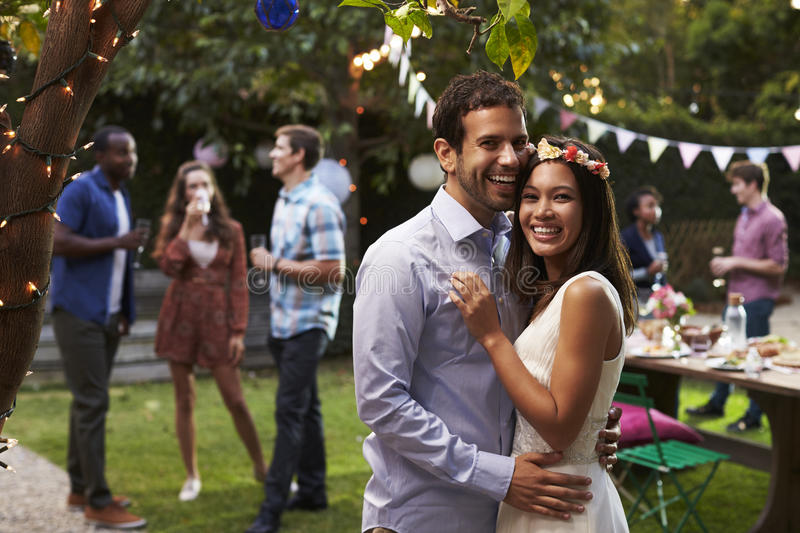 Portrait Of Couple Celebrating Wedding With Backyard Party royalty free stock photography