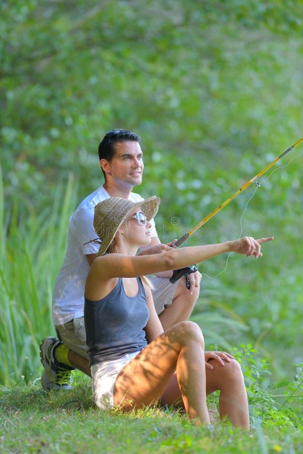 Portrait couple fishing. Portrait of a couple fishing stock images