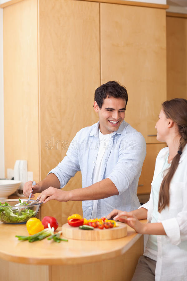 Download Portrait Of A Couple Preparing A Salad Stock Image - Image of handsome, 24: 22220073
